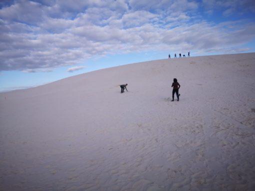 Sandboarding down Atlantis Dunes